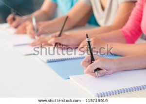 stock-photo-close-up-of-writing-hands-of-students-at-school-115746919